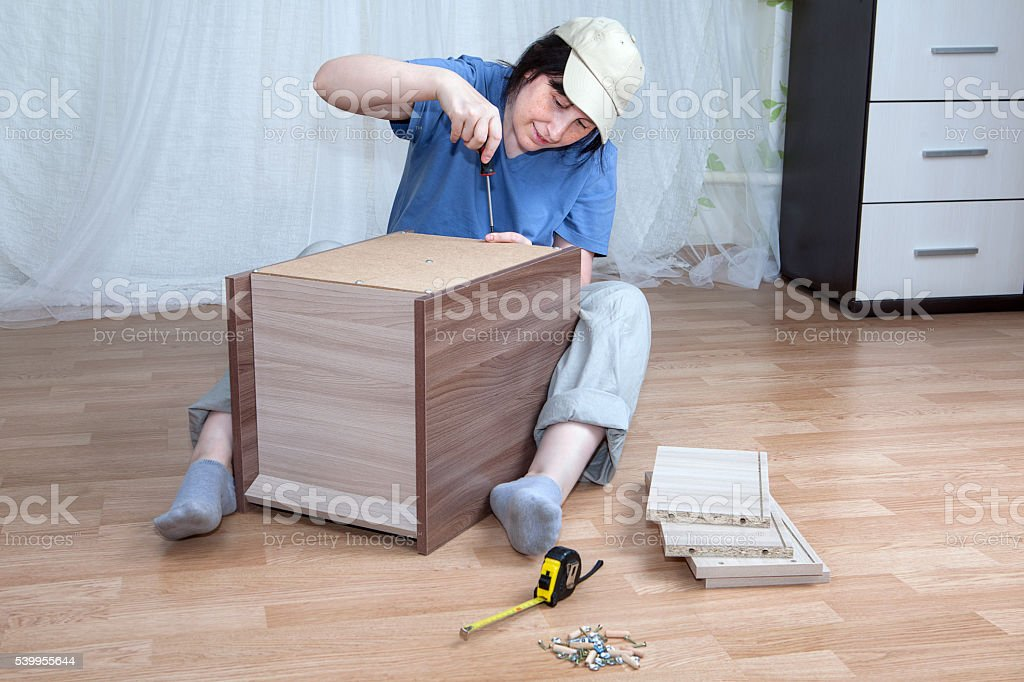 Self Assemble Furniture assemble wooden furniture woman putting together self assembly