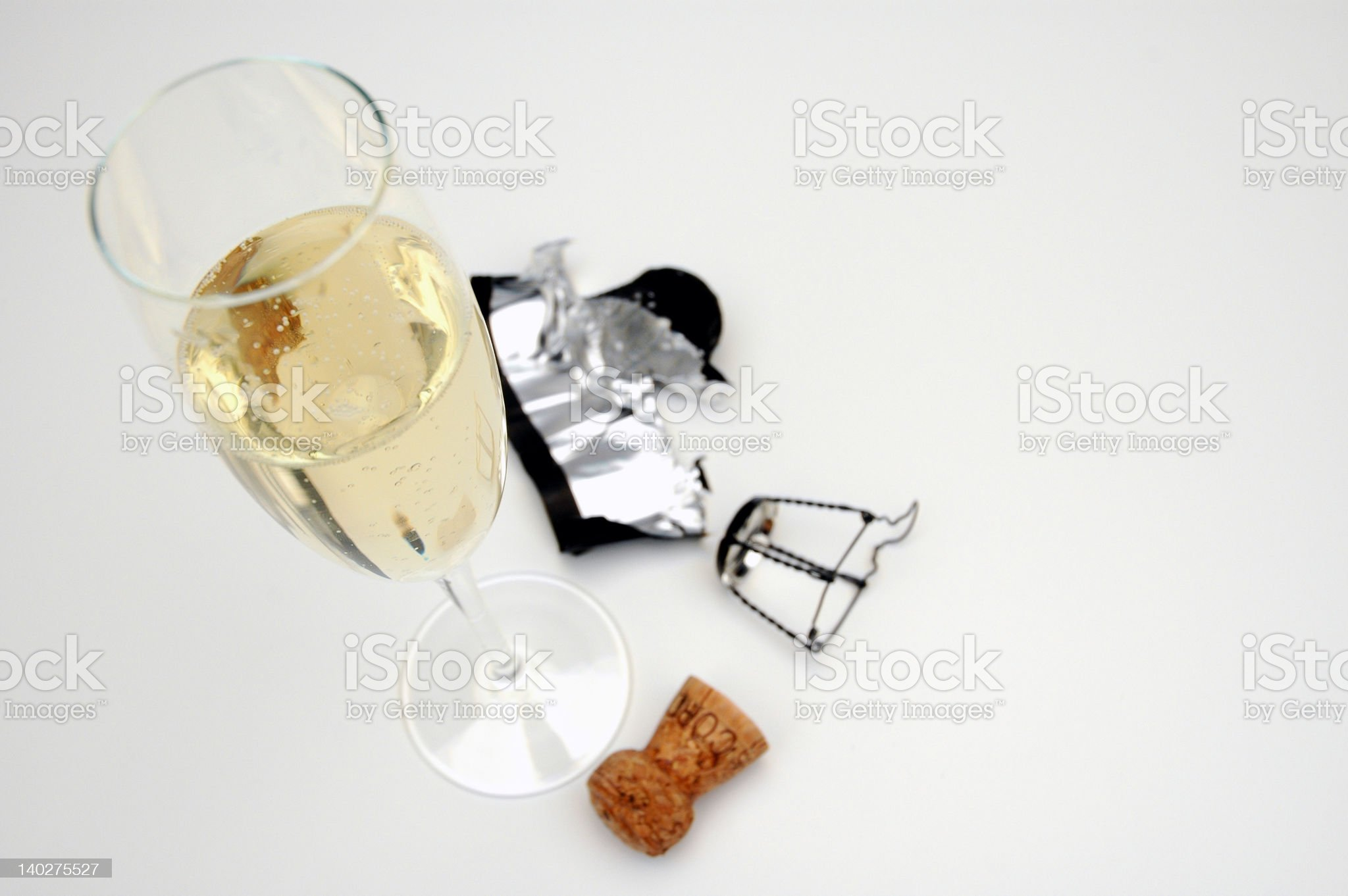 One champagne glass against white background royalty-free stock photo