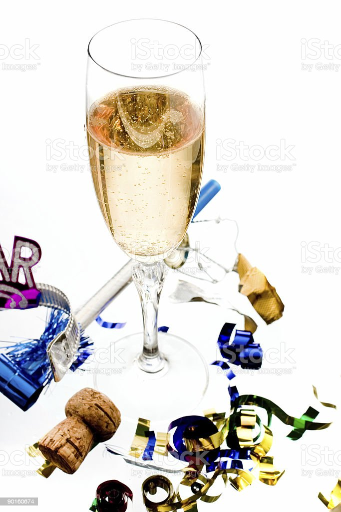 one champagne glass amongst party favors and cork royalty-free stock photo