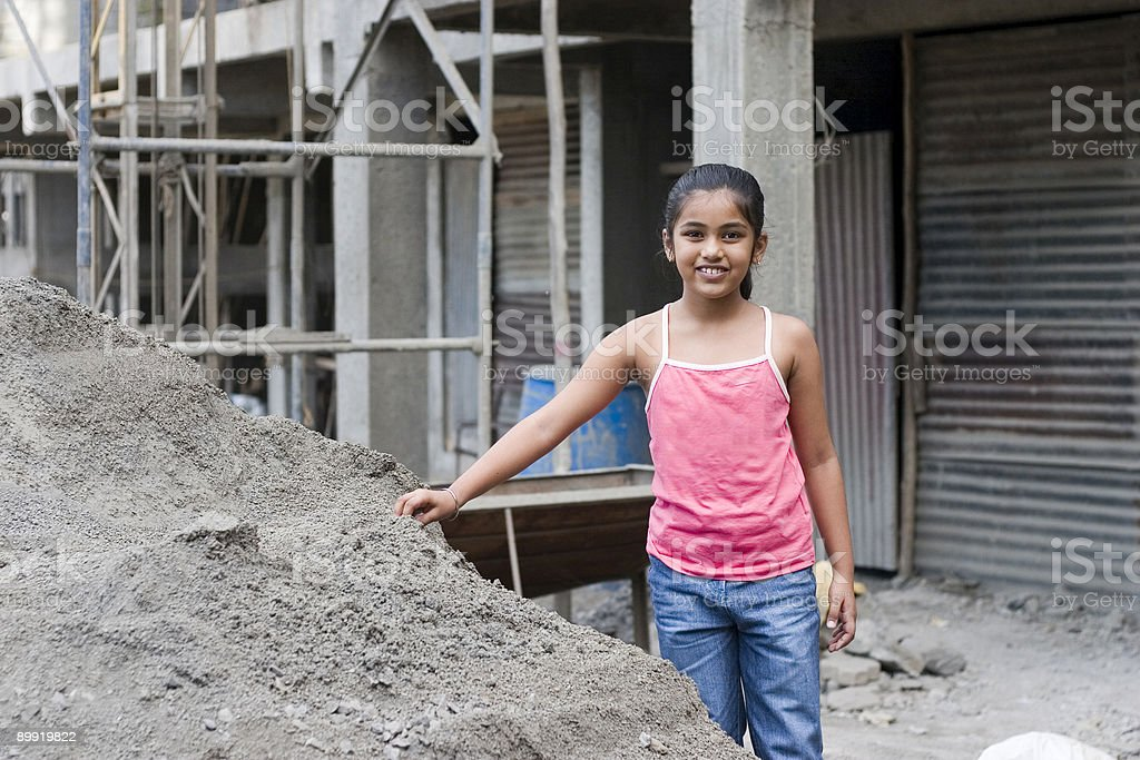 One Cheerful Indian Asian Girl Female Kid Construction Site Outdoor stock photo