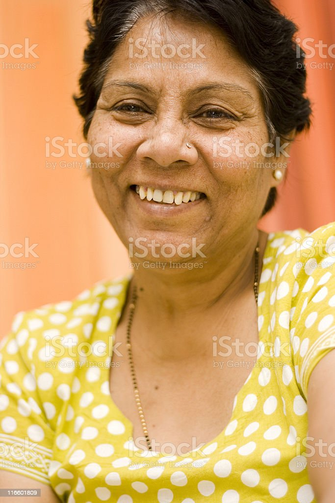 One Cheerful Indian Senior Lady female vertical portrait royalty-free stock photo