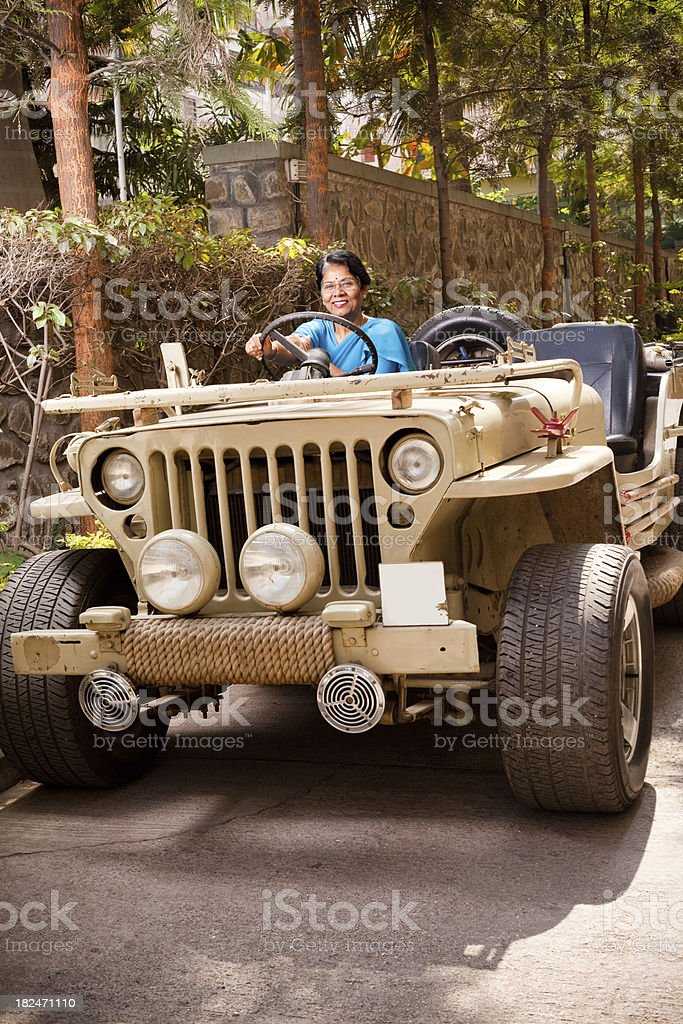 One Cheerful Indian Senior Woman with Jeep stock photo