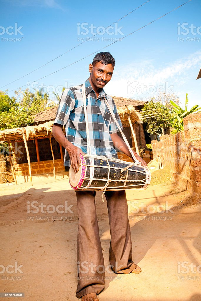 One Cheerful Rural Indian Man with a traditional Music Instrument royalty-free stock photo