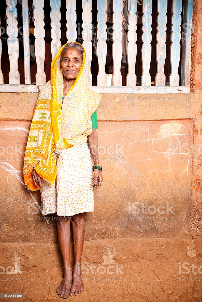 One Cheerful Rural Traditional Indian Woman Standing Vertical royalty-free stock photo