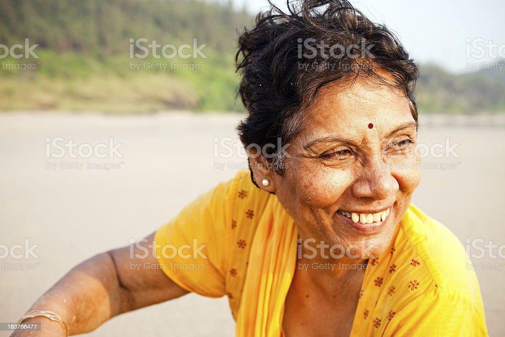 One Cheerful Senior Indian Woman Enjoying on Beach stock photo