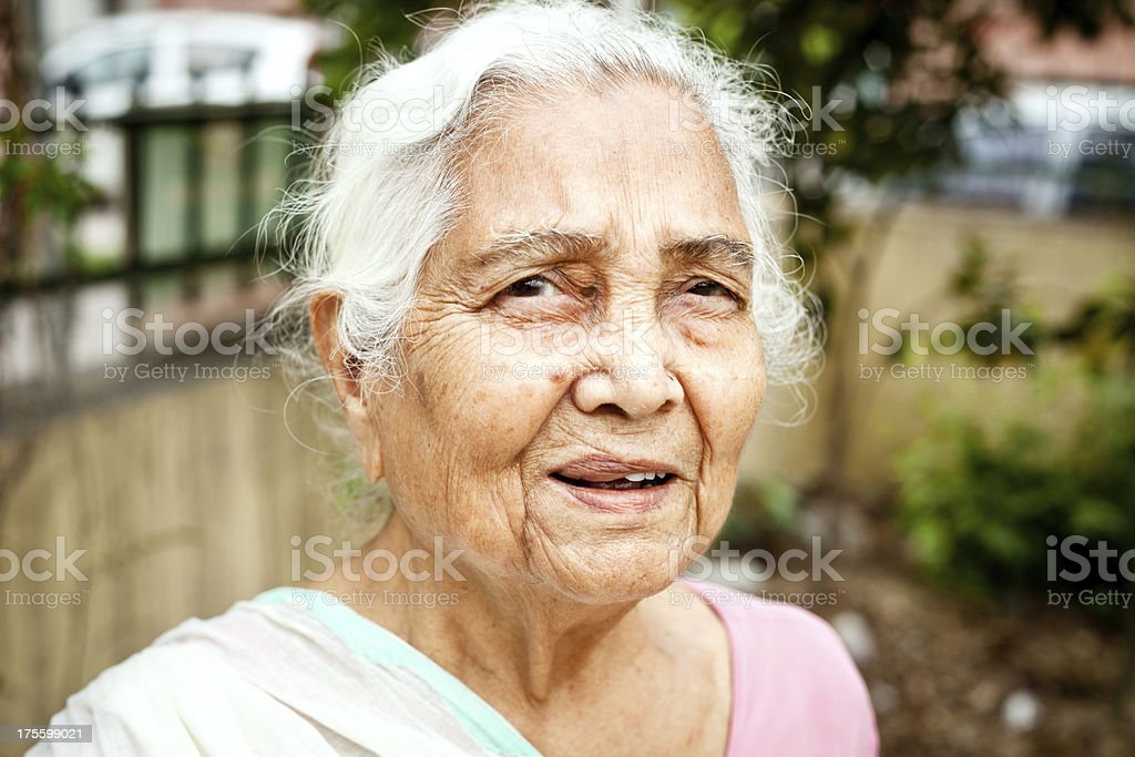 One cheerful senior Indian woman royalty-free stock photo