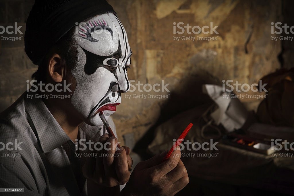 one Chinese opera actor in make-up stock photo
