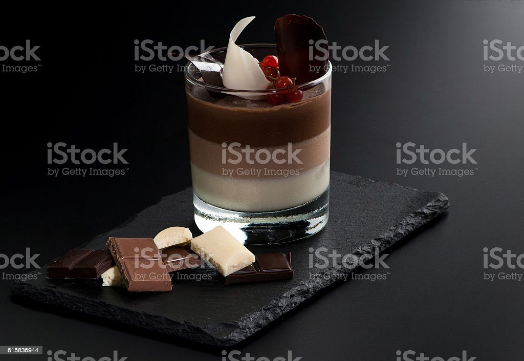 one cocktail in a glass with pieces of fruit on stock photo