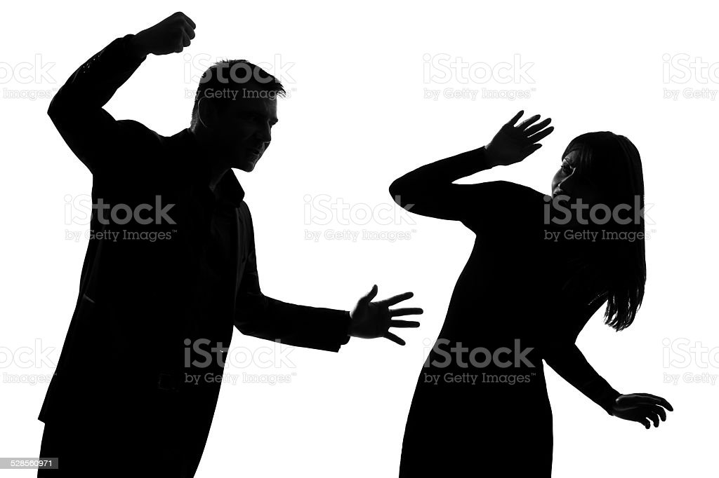 one couple man and woman domestic violence silhouette stock photo