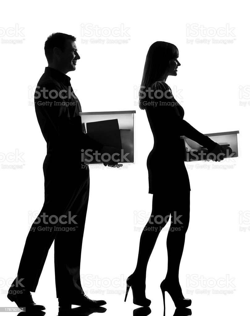 one couple man and woman walking carrying boxes happy royalty-free stock photo