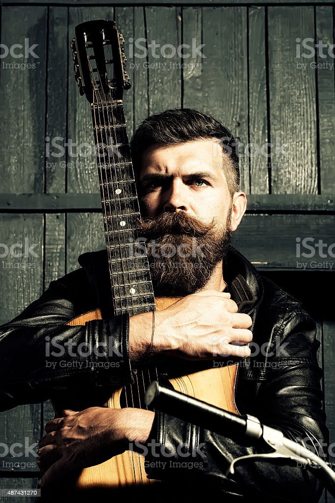 One creative man with guitar stock photo