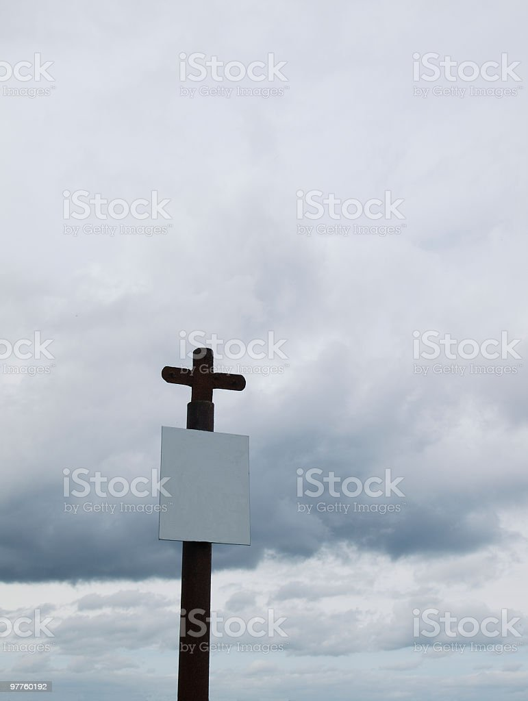 one  cross with white pane under cloudy sky stock photo