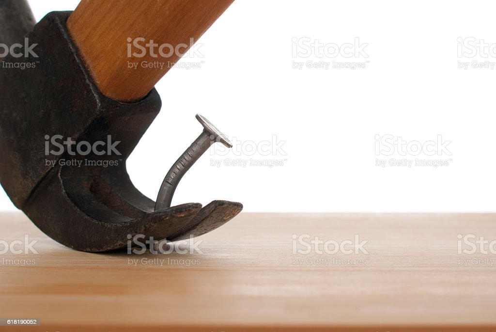 One curve iron nail and a hammer royalty-free stock photo