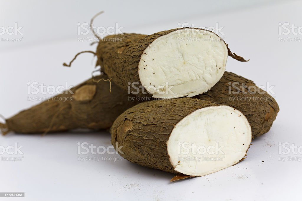 one cut cassava on a white background stock photo