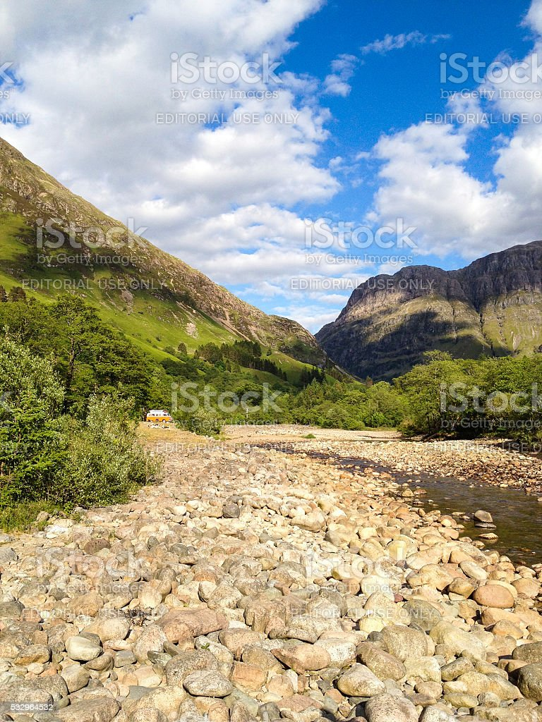 One Distant Vehicle Parked in Mountains of Glencoe, Scotland stock photo