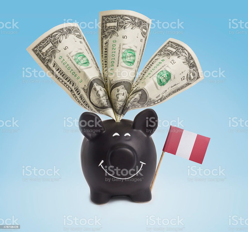 One dollar banknotes in a happy piggybank of Peru.(series) stock photo