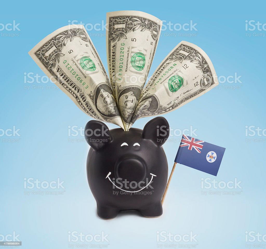 One dollar banknotes in a happy piggybank of Queensland.(series) stock photo