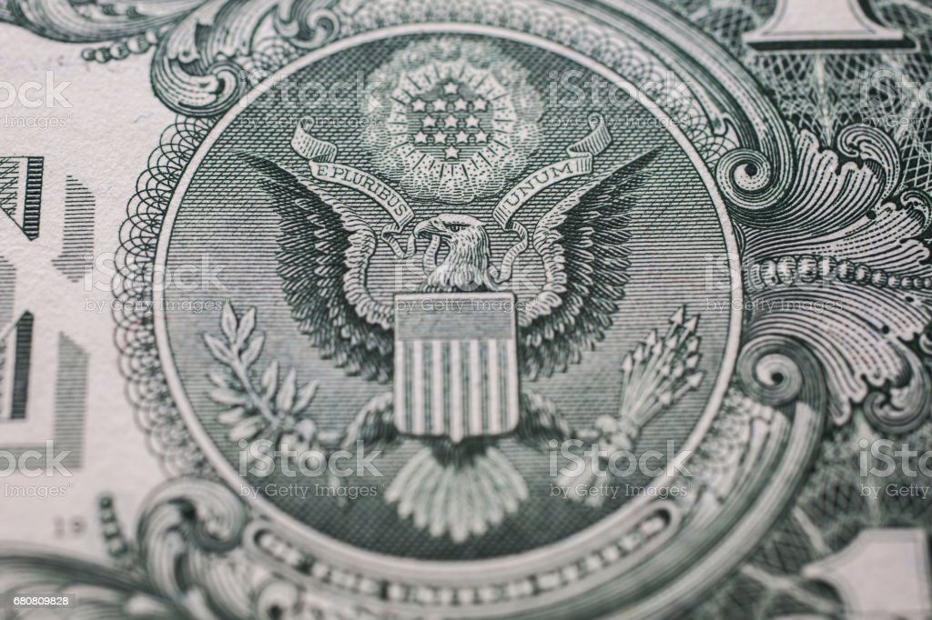one dollar bill down back reverse side, bald eagle, 13 arrows and an olive branch, money background, , background of dollars, close up, America stock photo