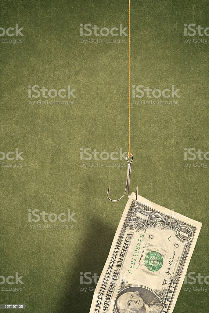 One dollar bill hooked on a fishing hook royalty-free stock photo