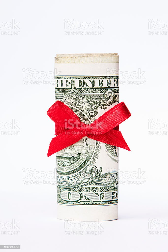 one dollar bill wrapped with a red bow stock photo