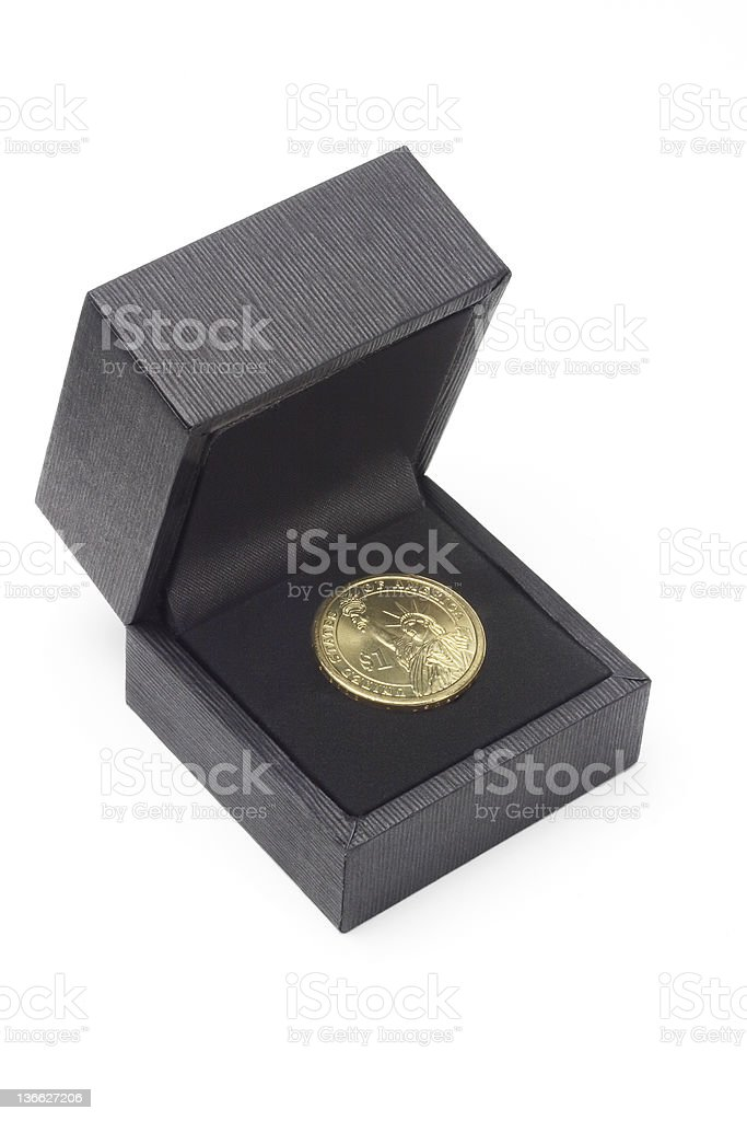 US one dollar coin in black gift box royalty-free stock photo