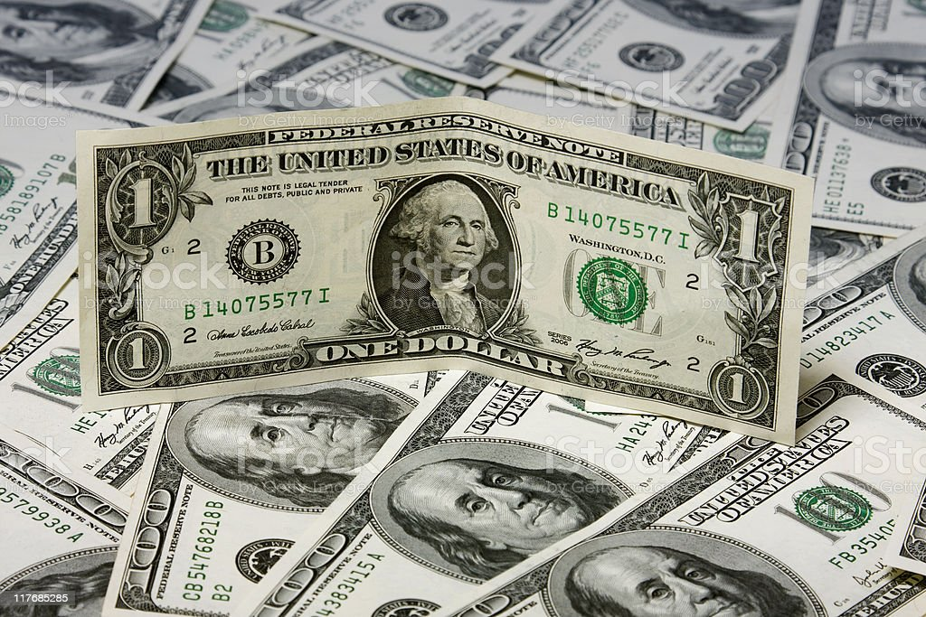 One dollar on hundred greenbacks pile stock photo