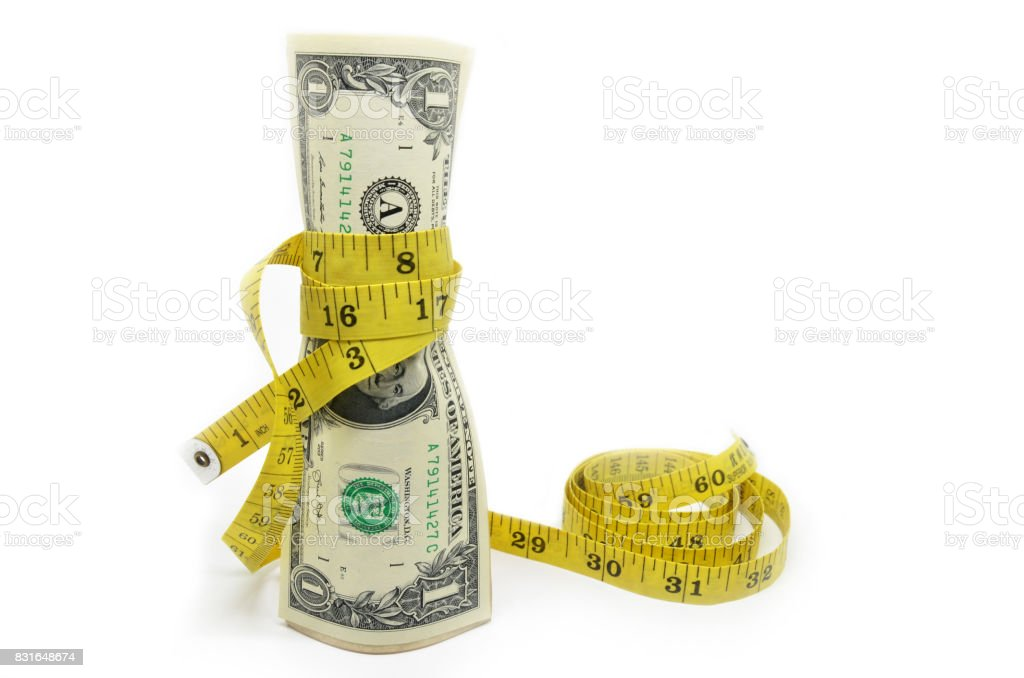 One dollars US money in measuring tape stock photo