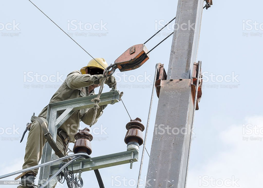 One electrician climbing and repairing for normal working. stock photo