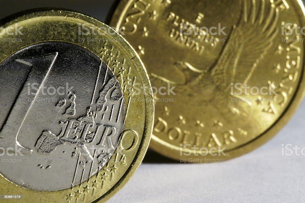One Euro and one Dollar coin royalty-free stock photo