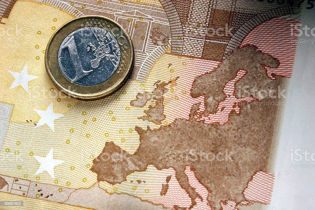 One Euro coin and a banknote royalty-free stock photo