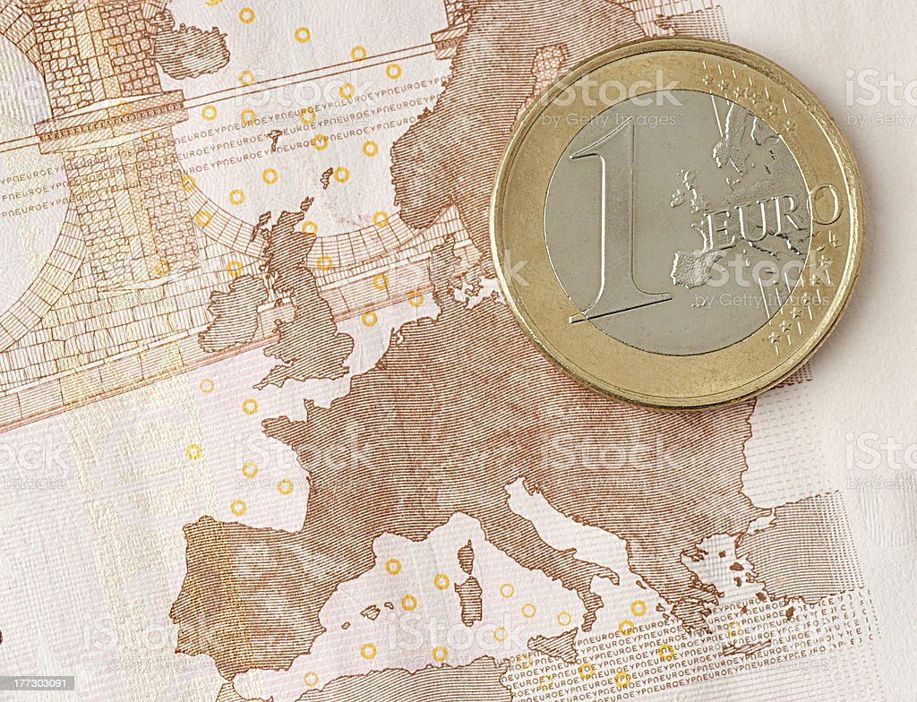 One Euro Coin and Banknote showing Map of Europe royalty-free stock photo