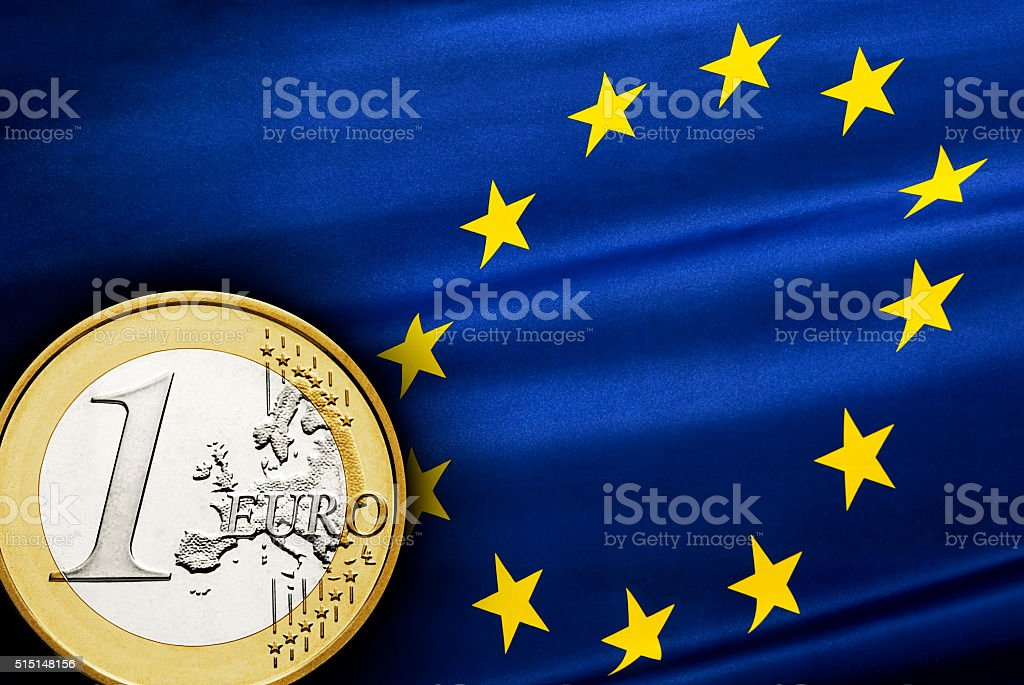 One euro coin and flag stock photo