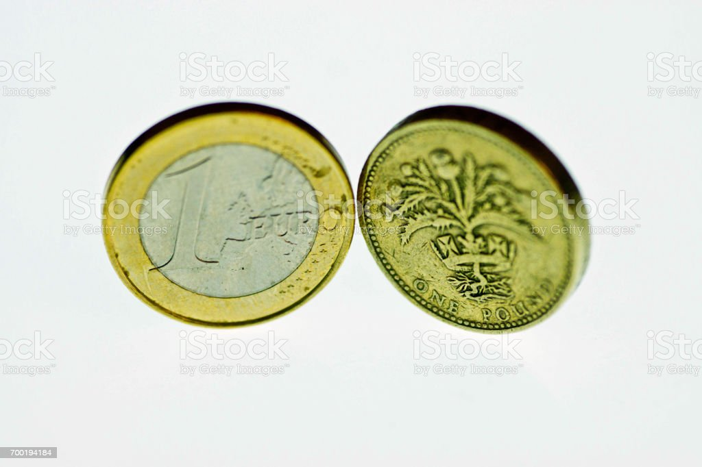 One euro coin and one pound coin stock photo