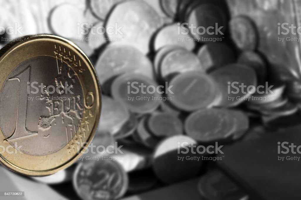 One Euro coin finance background stock photo
