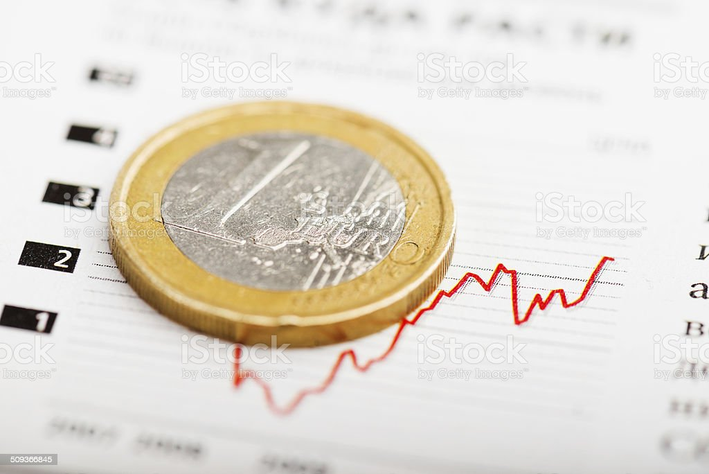 One euro coin on fluctuating graph. stock photo