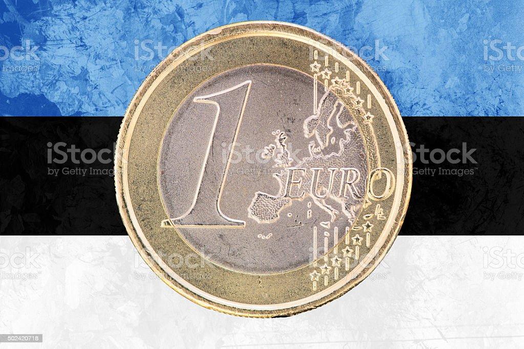 One euro coin on the flag of Estonia as background stock photo