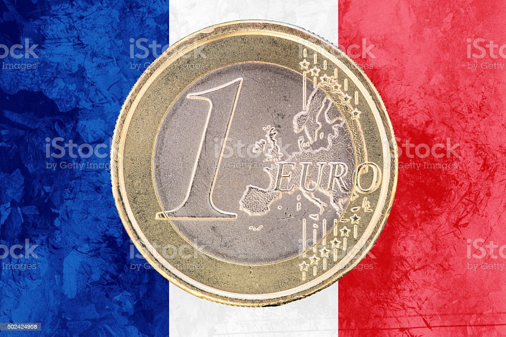 One euro coin on the flag of France as background stock photo