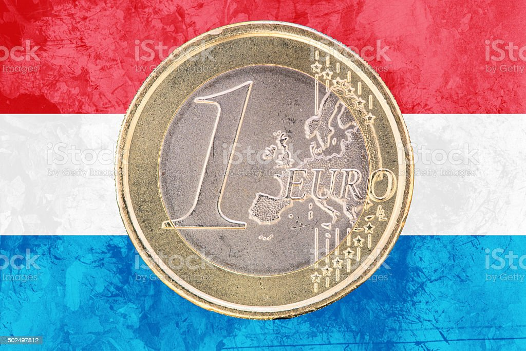 One euro coin on the flag of Luxembourg as background stock photo