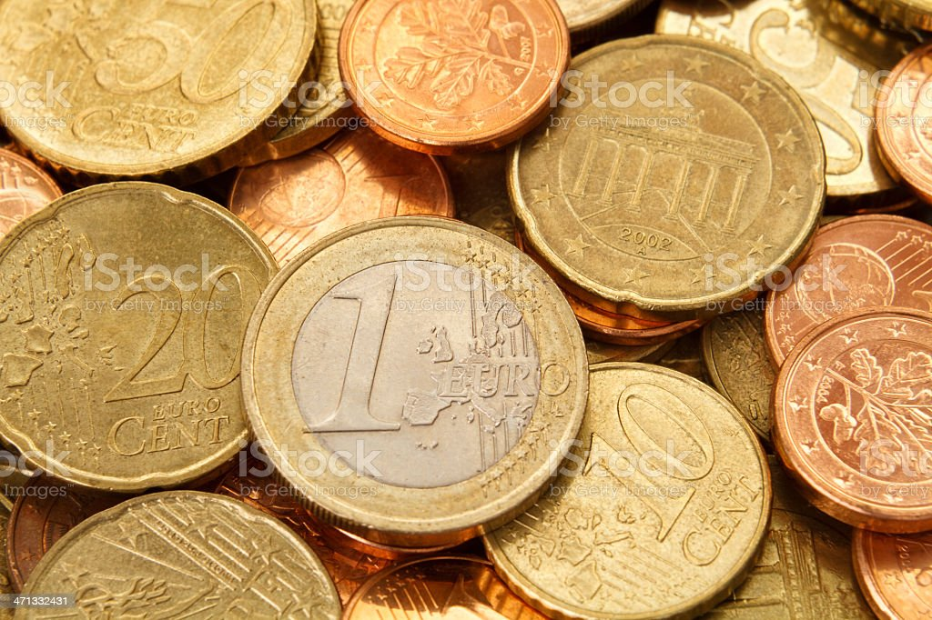 One Euro coin on top of other Euros coins stock photo