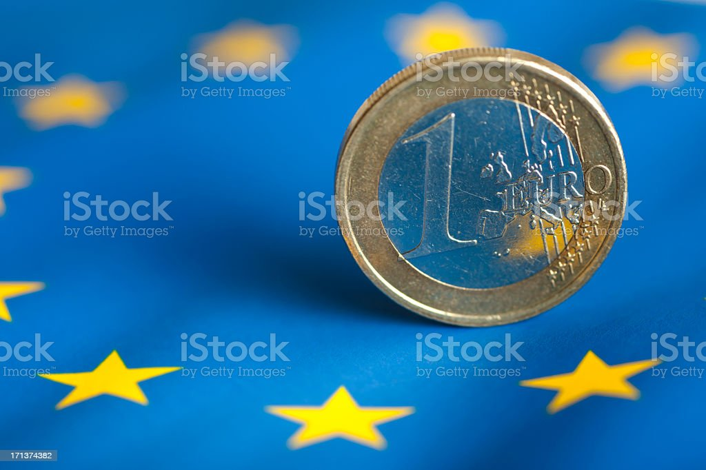 One euro coin with blue & yellow star background stock photo