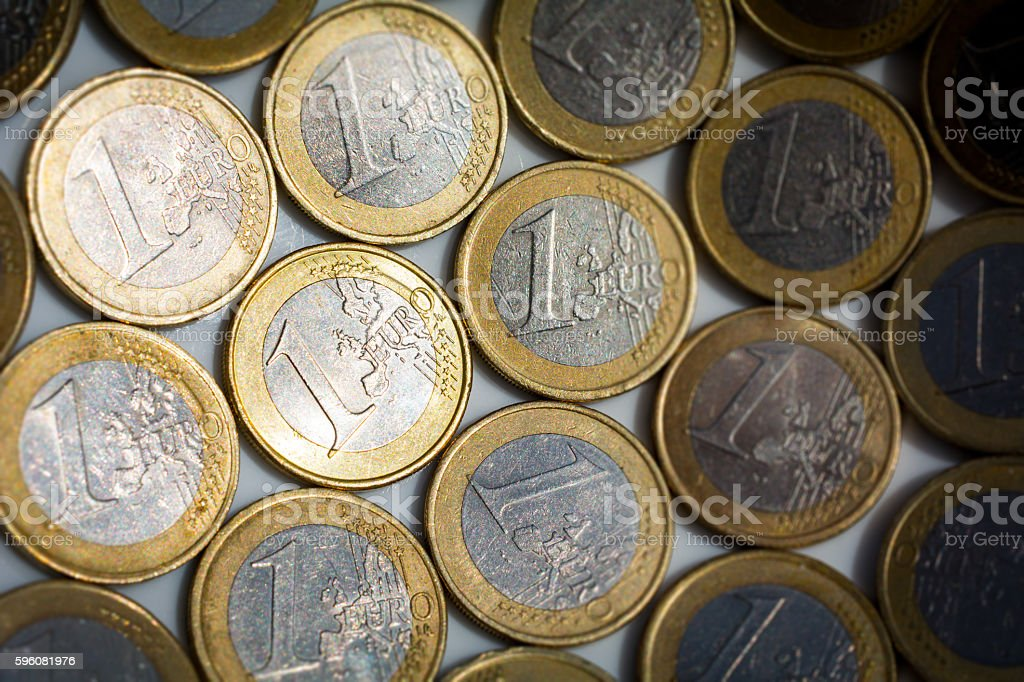 one euro coins in a bowl stock photo