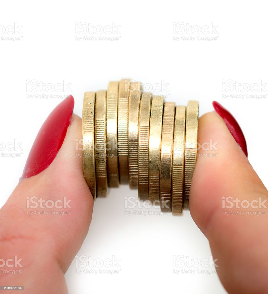 10  one euro coins stacked between her fingers stock photo