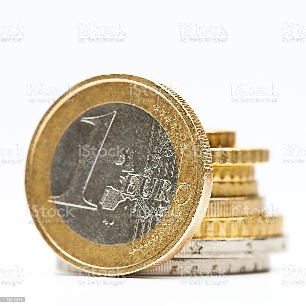 One Euro in front of coins stack royalty-free stock photo