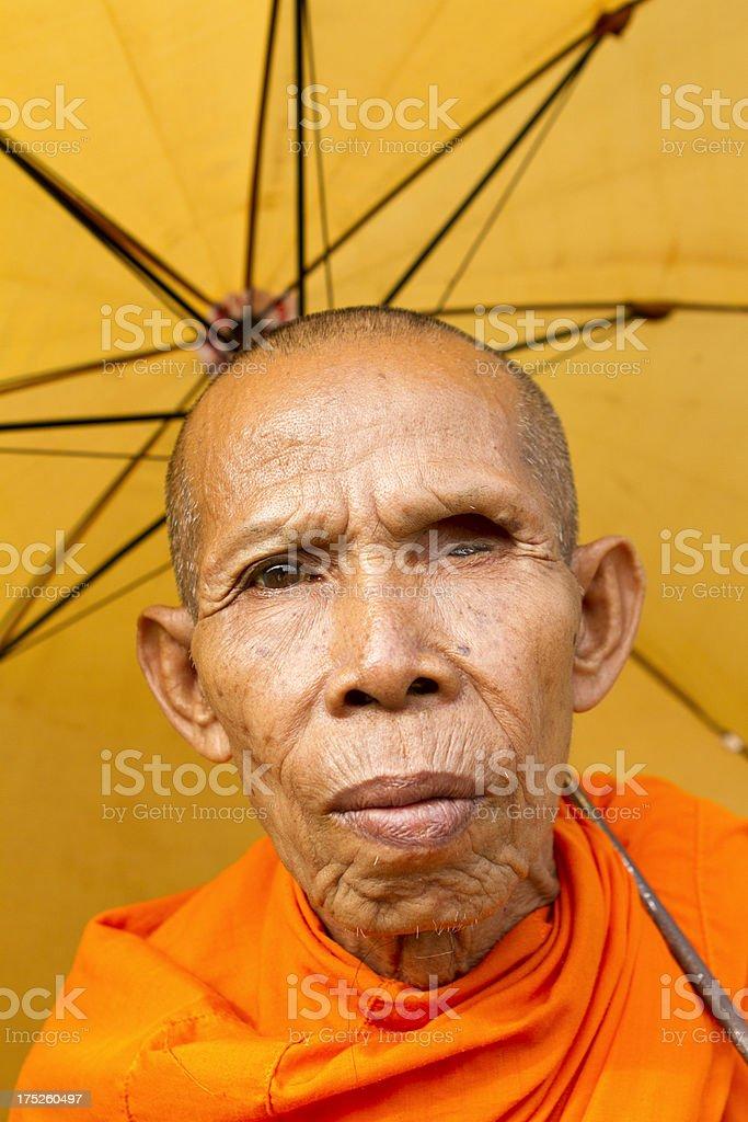 One eye old Buddhist monk royalty-free stock photo
