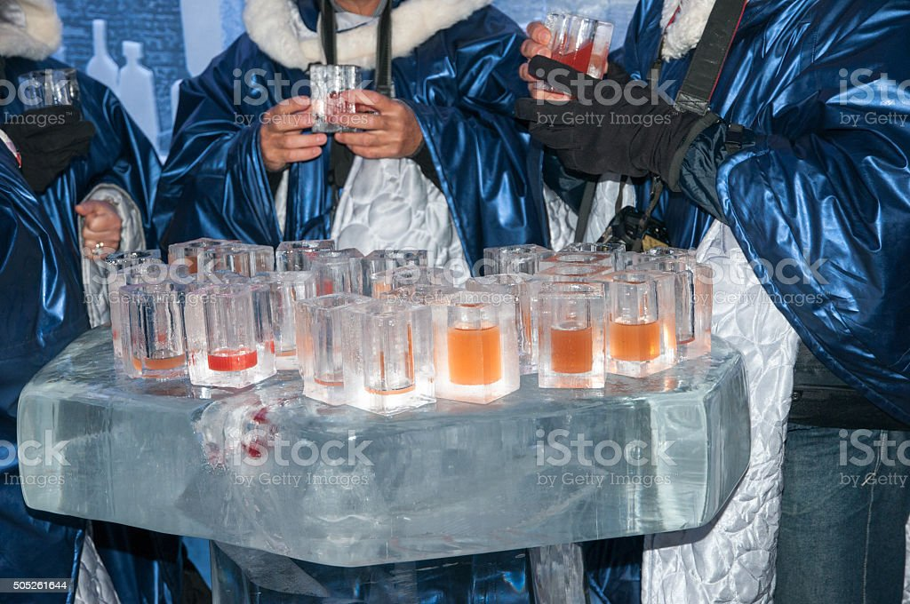 one family drinks in an ice bar in Oslo Norway stock photo
