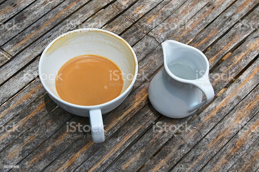 One finished cup of latte coffee on bamboo table royalty-free stock photo