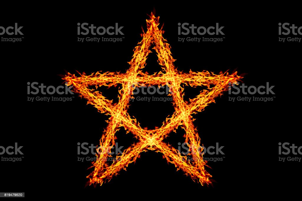 one fire star isolated on black stock photo