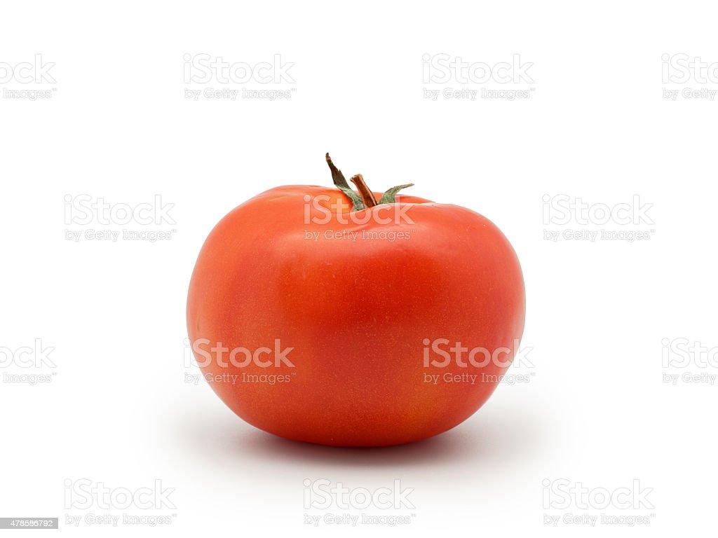 Um fresco, tomate vermelho isolado no fundo branco foto royalty-free