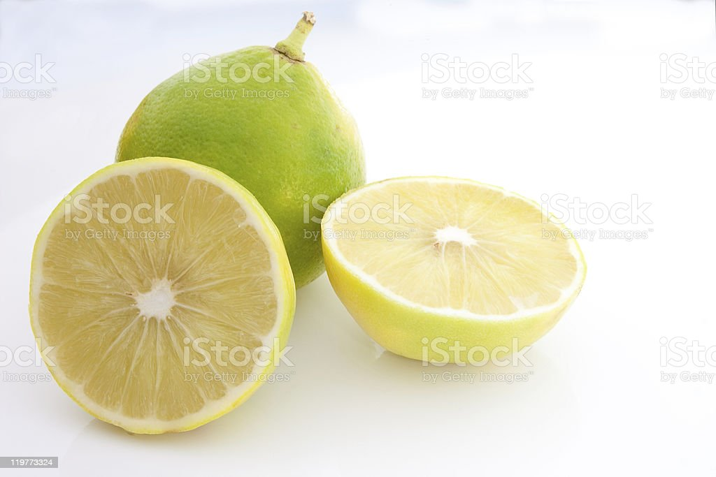 One full and two slices of green bergamot oranges stock photo