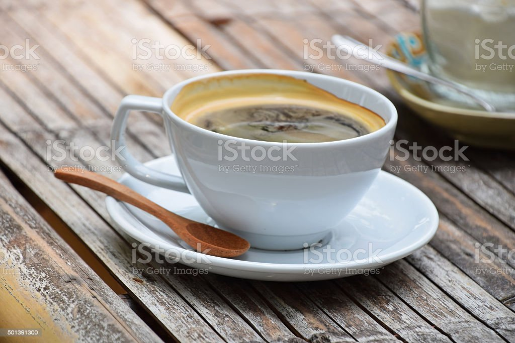 One full cup of Americano coffee on bamboo table royalty-free stock photo